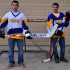 Tristan and Taylor Weinholzer gear up for the district ice hockey team.