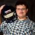 Freshman football player unable to play until a fitting helmet is found.